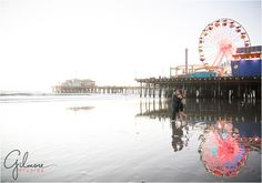 Jessica & Brett's Engagement Photography Session - Santa Monica Pier - Los Angeles, CA - boardwalk, ferris wheel, carnival, ride, games, beach, formal, dress, suit, couple, engaged, sunset, silhouette, GilmoreStudios.com