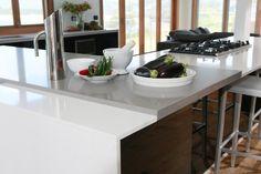 Guy Sebastian's holiday home. Kitchen by Freedom Kitchens. Dual-tone Caesarstone benchtops.