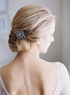 Elegant diamond barrette low bun hairstyle: http://www.stylemepretty.com/2017/01/27/winter-wedding-dubbed-by-the-couple-as-a-champagne-soaked-dance-party/ Photography: Bonnie Sen - http://bonniesen.com/