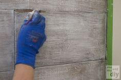 Fab Tutorial for creating this Faux Weathered Wood Paneled Wall using Tinted Clear Stain, White Wash Pickling Stain & Paste Wax.