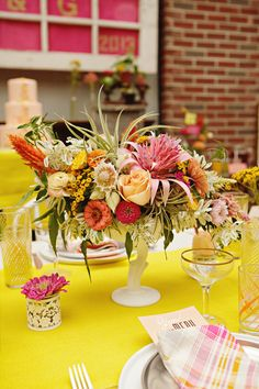 colorful centerpiece on yellow table // photo by Sweet Monday Photography, flowers by Peacock Blooms Floral Design // View more: http://ruffledblog.com/late-summer-citrus-inspiration/