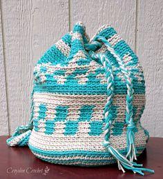 Crochet this mochila inspired backpack using Bernat Maker Home Dec yarn. Free pattern by Croyden Crochet.