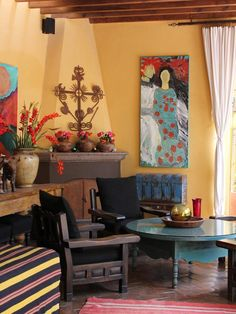 for Mexican-inspired look, paint patio walls a warm bold color, and spray-paint old furniture for rustic look