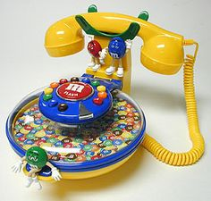 PhoneVault M&M Candy Dish Phone - This cute phone is also a candy dish that is decorated with M&M® characters. M M Candy, Best Candy, Et Phone Home, M&m Characters, Food Pillows, Disney Frozen Party, Call Me Maybe, Candy Dispenser, Wall Desk