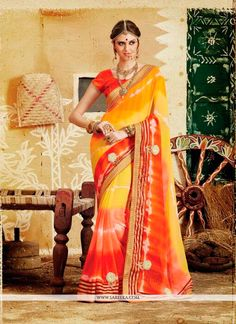 Add grace and charm towards the look in this desirable multi colour georgette designer saree. This attractive attire is displaying some brilliant embroidery done with patch border and print work. Come...