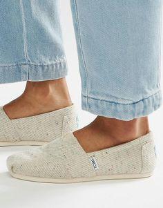Bild 1 von TOMS – Gesprenkelte flache Schuhe mit Kunstfell