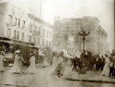 """Fifth and Main Street in 1908.  The Leonide Hotel is 2nd from left. Looks like the streetcar banner is promoting a Labor Day middleweight boxing championship fight between Stanley Ketchel and Billy Papke.  The Leonide Hotel """"Ghost Sign"""" can be seen here: http://www.flickr.com/photos/viajante/2833481098/.  Bizarre Los Angeles."""