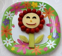 Cute flower shaped sandwich, made of bread, cheese, tomatoes, cucumber, radish and olive. It is a great idea for spring or summer time and kids can help in the preparation. #sandwichrecipe, #flowersandwich, #sandwichforkids