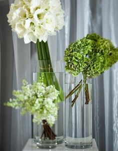 Tilt arrangements... white amaryllis, green hydrangea, white lilacs.