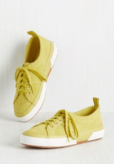 You never let your sense of stylish innovation rest, as is evident by these suede sneakers! The sassy citrus yellow hue of this Superga activewear is excelled by edgy pinking and white sole accents, proving that you always 'stride' for - and achieve - ace fashion status.