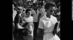 "Content Area Close Reading: Read images. Look at main ""characters""; setting, physical and emotional; secondary characters; foreground and background  CNN: Students of Central High School in Little Rock, Arkansas, shout insults at Elizabeth Eckford as she walks toward the school building on the first day of school in 1957. Schools in Arkansas integrated races after the Supreme Court ruling in Brown v. Board of Education."