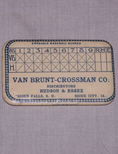Tiny blue and white erasable baseball scoring card pocket mirror with a charming baseball border. 'Van Brunt – Crossman Co. Distributors Hudson & Essex of Sioux Falls, South Dakota and Sioux Falls, Iowa'. The very edge of the mirror reads, 'Parisian Nov. Co. – Chicago'. 2 3/4″ x 1 3/4″.