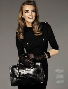 WOW, everything!  First the purse...oooh, then the gloves, oh and the shirt and finally the model...everything is stunning!