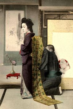 A geisha and her dresser. Meiji era.