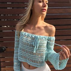 The off shoulder crochet top is hand crocheted with love by our women's collective in Bali. Perfect for festival looks and warm summer days. This is a one size item, which fits size S-L Content + Care - 100% cotton - hand wash - hang dry Size + Fit - one size fits S-L