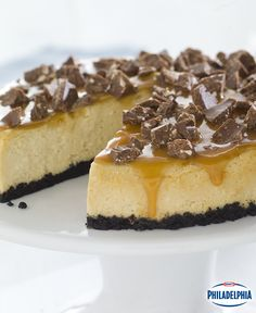 Impress family and friends with this gooey caramel and milk chocolate candy cheesecake. It makes for a showstopping holiday dessert!