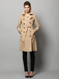 camel trench paired with ankle length black skinny pants