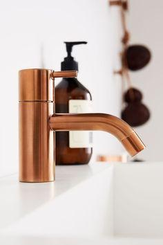 copper basin mixer tap   Vola HV1, designed by Arne Jacobsen in 1968
