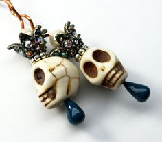 Howlite skulls, pewter tone crowns, Copper wire and French ear wires. Unique!  Earrings drop 3-3/4 inches from top of ear wires.  Gift pouch included.