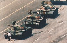 1989 - A demonstrator confronts a line of People's Liberation Army tanks during protests for democratic reform. (Charlie Cole)
