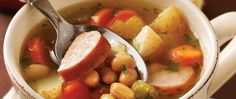 Stock the slow cooker with this smoky sausage and bean soup, rounded out nicely with a complementary selection of veggies and herbs. It takes just 15 minutes to assemble.