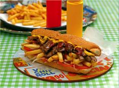 Unique to South Africa, the Gatsby is a long bread roll stuffed with a meat or fish filling and fried chips with a chilli sauce. Cheesy Recipes, Beef Recipes, South African Recipes, Ethnic Recipes, Kos, Rolled Sandwiches, Fried Chips, Rolls Recipe, International Recipes