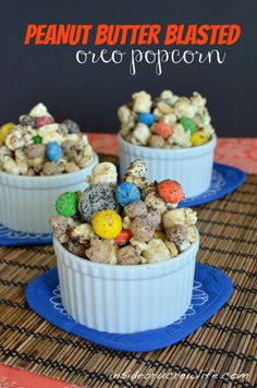 Peanut Butter Blasted Popcorn Munch- Peanut butter white chocolate covered popcorn, peanut butter MM's and Oreos make this a very addicting popcorn #Oreo #chocolatecoveredpopcorn http://www.insidebrucrewlife.com