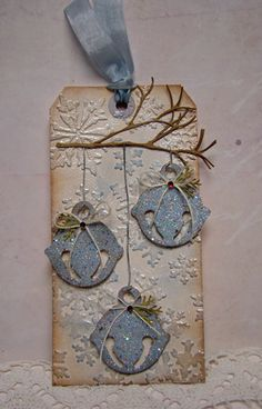 handmade Christmas tag ... sponged edges on snowflake textured tag ...  die cut branch with three die cut jingle bells ... great winter look ...