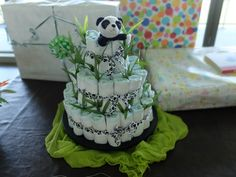 DYI diaper cake. Cute little Panda on top and purchased in Wal-Mart ribbon with paws. Little bamboo shoots are from Lily-of-the-Valley branch purchased in Wal-Mart