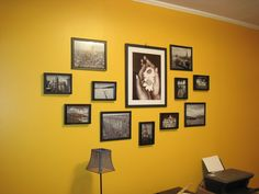Bright yellow wall with black and white travel pictures- fun!