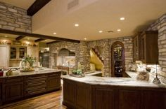 Love the recessed lighting and the wine cabinet and the marble countertops!
