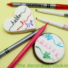 Tips for drawing on food and review of several edible marker brands.  This is would make much less of a mess than giving kids frosting and sprinkles.  http://www.thedecoratedcookieblog.com/p/how-to-draw-on-food.html