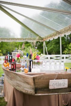 A #boat re-purposed as a #bar for your next get together! // StyleMePretty.com- #Weddings #Nautical