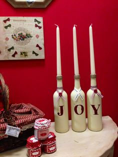 Wine bottles painted in Annie Sloan cream chalk paint and stencilled in burgundy.