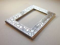 Sterling silver photo frame Solid silver picture frame Art Nouveau design Tulips and leaves pattern Silver frame Hallmarked London 1987 by nancyplage on Etsy https://www.etsy.com/listing/265561557/sterling-silver-photo-frame-solid-silver