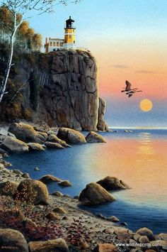 """As the bright orange sun nears the horizon, a pair of Canadian Geese pass by the lighthouse as the edge of the cliff. Signed and Numbered Image Size 12"""" x 7.75"""""""