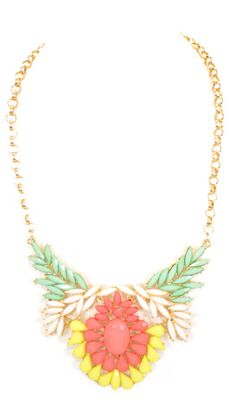 Statement necklace with mint, ivory, coral, and yellow gems. $34 at shopbluedoor.com