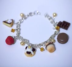 """Super cute Sterling Silver Mini Chocolate Charms Bracelets!!! How cute is that!!! The bracelet measures approx. 7.0 inch long. Each charm measures approx. 0.5"""" and the handmade charms are: ~ Chocolate Banana Pie ~ Chocolate Cherry Cupcake ~ Chocolate Saint Honore Pastry ~ Chocolate Macar..."""