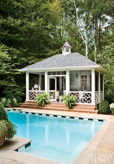 Freestanding screened-in porch with Chinese Chippendale detailing. Architecture by Norman Askins. Photo by Erica George Dines. From Atlanta Homes & Lifestyles.