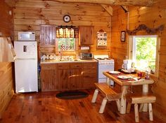 Porch ceiling beams log homes cabins rustic decor for Small log cabin kitchens