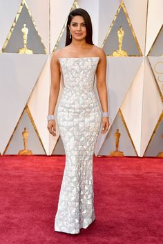 """What do you think of Priyanka Chopra's gown? <a rel=""""nofollow"""" href=""""https://www.yahoo.com/style/oscars-2017-vote-for-the-best-and-worst-dressed-225105125.html"""">Click here to vote</a>! <em>(Photo: Getty Images)</em>"""