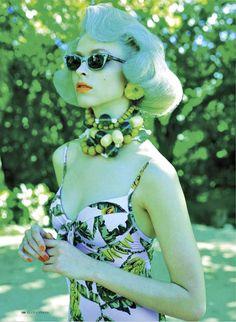 Ultimate chic.  Green hair, orange lips, sexy underwire bodysuit, cat eye glasses... the oompa loompa look is stellar.  ELLE Canada