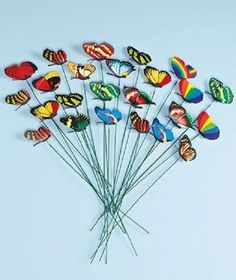 Grace your yard, garden or flower bed with a rainbow of beautiful creatures with these Butterfly Garden Ornaments. You can also use them indoors to add a lovely look to potted plants. You get a wide array of colors and designs. Each figure is on a thin metal stake that's easy to conceal to give the illusion of real butterflies. A small spring attaches each butterfly to its stake, so it will sway slightly in a breeze. The wings can be pushed open or shut for varied display.