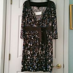 BCBG MAXAZRIA WRAP V NECK 3/4 SLEEVE DRESS NWT! BCBG MAXAZRIA V NECK WRAP TOP 3/4 SLEEVE DRESS. BLUE, BLACK, BROWN, WHITE, TAN, CREAM Comfy, Slinky, Doesn't Wrinkle Easy Material!  SIZE LARGE  NEW WITH TAGS (NWT!) From A Local Boutique. 94% POLYESTER, 6% SPANDEX  No Smoking, No Trades, Buy it Now, Ask Questions, Make an Offer, Posh Only! BCBGMaxAzria Dresses Midi