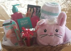 B'day pressie for 11 year old girl- bunny ultra soft slippers, maybelline baby lips, soft ribbon hair ties, cupcake style ball of elastic hair ties, ultra soft house socks, strawberry shower gel, hairband and comb.
