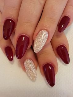 Oval acrylics with gel nail polish, with silver sparkle accent.