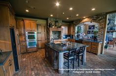 Custom rustic house plan for one of our clients.  Clients dream kitchen with rustic flair.