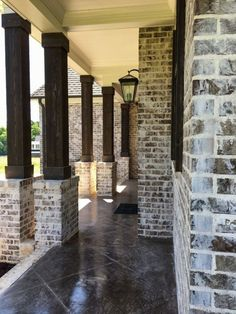 german smear mortar on a dark brick is a great look! Summit Brick's Andiron or Ebony would look amazing Brick Columns, Porch Columns, Brick Facade, Brick Siding, D House, House With Porch, Exterior House Colors, Exterior Design, Brick Design