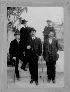 Svoronos, Ioannis Nikolaos (1863-1922), keeper of the Numismatic Museum of Athens (1890-1922), picture with two foremen and his son Aristaios (in seaman suit at the rear) (picture transmitted by Alexis Hadjimichalis, his great-grandson and grandson of Aristaios)
