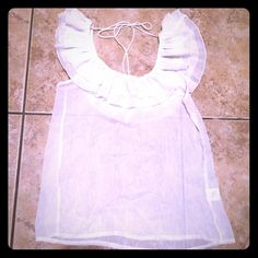 White silver Ruffle blouse with tie back White silver Ruffle blouse with tie back. Gently used. No known defects. White with silver pin striping. Scoop neck type neckline. The back tie holds up the blouse in case you want to to be off the shoulder. Size is medium but it's pretty roomy. 100% polyester. Charlotte Russe Tops Blouses
